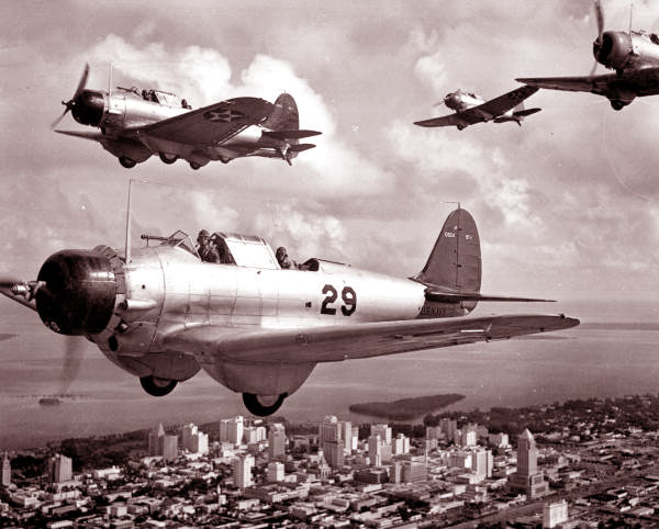 U.S. Navy dive bombers flying over Miami during WWII